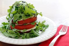 Tomato Mozzarella and Arugula Tower Gina's Weight Watcher Recipes Servings: 2 • Size: 1 tomato • Points +: 8 pts • Smart Points: 8 Calories: 276.6 • Fat: 23 g • Protein: 12.2 g • Carb: 9.2 g • Fiber: 1.9 g • Sugar: 1.4 g Sodium:  349.2 mg (without salt)