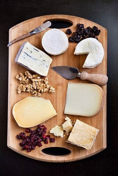 Assorted cheeses, nuts, and dried fruit. All I need is a bottle of wine and a baguette..