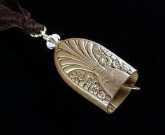 Bell chime necklaces made from antique hollow dinner knives by Dishfunctional Designs