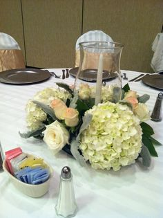 Candle, hydrangea and rose centerpiece by Fields in Bloom