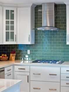 """Green: Calming and Comfortable. Neither bright nor pastel; not pale or neon, the soft blue-green of this backsplash tile in a kitchen by Ryan Christenson of Remodel Works Bath and Kitchen is unusual enough to catch the eye, but subtle enough to live with comfortably for years."""