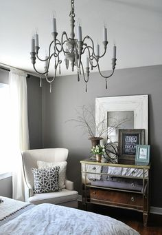 Grey and white bedroom and whoah that's the chandalier in there but painted grey!