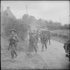 Infantry moving up during attacks between Hill 112 and Hill 113 in the Odon valley, 16 July 1944.
