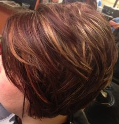 Asymmetrical, inverted bob, caramel highlights. Short hair.