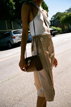 The satiny finish over the tan of the skirt plays perfectly in the sun to create a piece you'll find ...