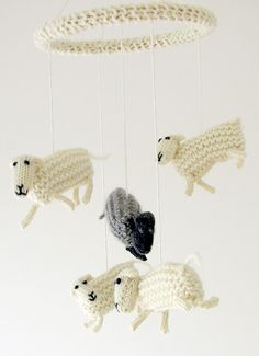 Free Knitting Pattern for Counting Sheep Mobile - Five toy sheep suspended from a covered wooden embroidery hoop make an adorable mobile for baby. The sheep are approximately 10cm long and 8cm tall. Mobile as shown is approximately 48cm in length by 18cm across. Designed by Jessica Gutoski. I think it would be fun to knit the sheep in different bright colors for baby.