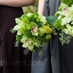 Lime-green flowers, including cymbidium orchids, button mums, bells of Ireland, hydrangeas, and tricillium, popped against the bridesmaids' dark dresses.