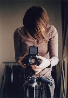 woman with old/vintage/retro camera, (photography, photographer)
