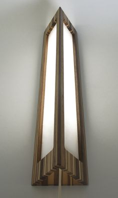 Mitz Takahashi Wall Mounted Lamp II    made from reclaimed walnut, birch, mahogany, red oak    with Japanese paper shade.