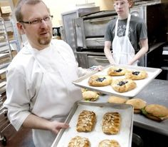 Mark Grodkowski works with his son Michael at Sweetly Divine in Logan, Utah. (Eli Lucero/Herald Journal)