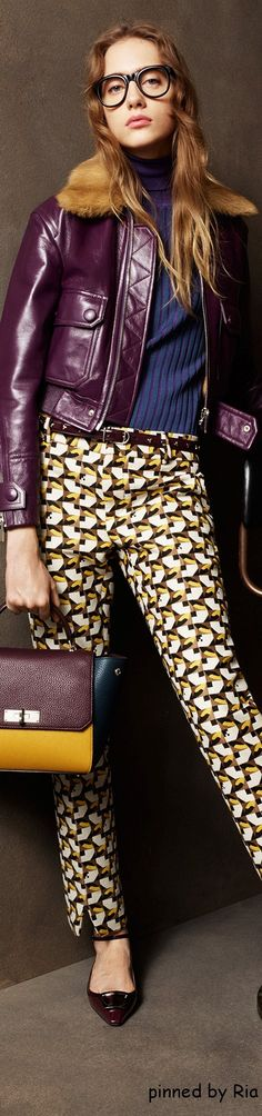 Bally Pre F-16: eggplant leather jacket, knitted turtleneck top, printed pants.