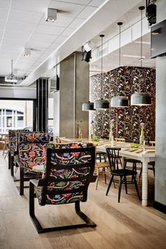 Cozy cafe at the Generator Hostel with floral upholstered seating