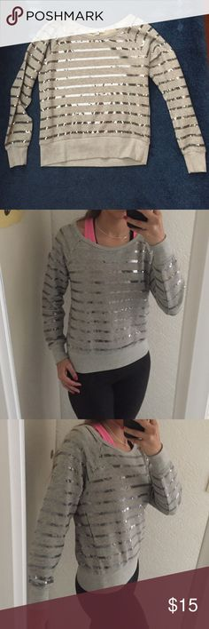 Forever 21 grey sequin sweater Very cute, barely worn. Can be worn as over the shoulder. Loose and comfortable fit but still accentuates your figure in a nice way. 62% cotton and 38% polyester Forever 21 Tops Sweatshirts & Hoodies