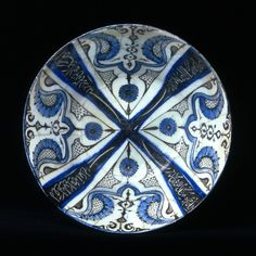 Fritware bowl, painted in black and blue under a transparent glaze Iran, Kashan; beginning of 13th century