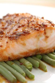A recipe for Baked Maple-Mustard Glazed Salmon made with salmon fillets, maple syrup, coarse-grain mustard, brown sugar, fresh Maple Syrup Salmon, Maple Mustard Salmon, Honey Glazed Salmon Recipe, Teriyaki Glazed Salmon, Brown Sugar Salmon, Maple Glazed Salmon, Ginger Salmon, Spicy Salmon, Salmon Glaze