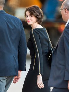 Anne Hathaway looks glamorous in her zipper-embellished LBD while making her way to Jimmy Kimmel Live in L.A. on Monday.