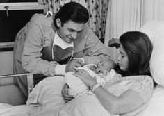Cash & June Carter Cash welcome a new addition.Johnny Cash & June Carter Cash welcome a new addition. Johnny Cash June Carter, Johnny E June, Johnny Cash Kids, Country Musicians, Country Music Artists, Country Singers, Arkansas, John Cash, Musica Country