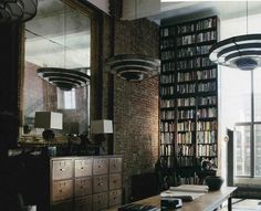 ink and post: SOHO FACTORY CONVERSION - I love this floor to ceiling library.