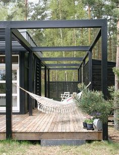 Structure a little to modern for me but love the hammock on the deck!!!