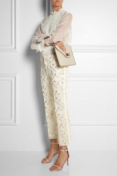 Chloé     Zigzag jacquard straight-leg pants     $1,035Taking her cue from '60s London Mod girls and the French yé-yé pop movement, Claire Waight Keller's Pre Fall Chloé motifs were inspired by vintage Fender guitars and musical notes. These gold and cream jacquard pants are a glamorous interpretation of the theme. Emulate the brand's chic styling with a blouse and heels.