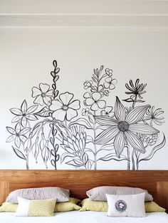 A Painted Headboard. Paint white outlines on chalkboard wall. They can color with chalk.
