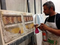 iLia Anossov (fresco) aging a first fresco layer for multi-layer didactic fresco panel for Introduction to Fresco Painting Professional workshop at the 2013 IDAL Convention.