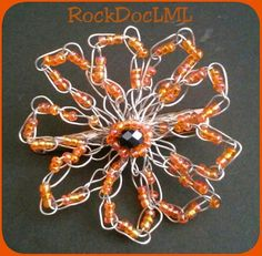 Check out this item in my Etsy shop https://www.etsy.com/listing/258593616/orange-daisy-flower-wire-crochet-hair