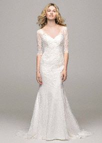 Demure yet stylish, this 3/4 sleeve all over lace trumpet gown is the epitome of classic beauty!  Trumpet gown features all over delicate lace detail and stunning V neckline.  3/4 sleeve bodice adds just the right amount of coverage. Chapel train. Soft White. (THIS IS MY DRESS)