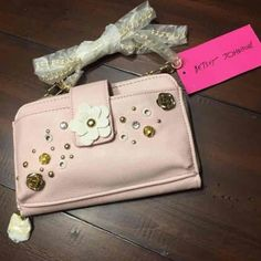 """Beaty Johnson Crossbody Purse. NWT Authentic Pushing Daisies Crissbody, Phone Purse. So adorable. Lite pick with gold hardware   Please of pockets inside and a pocket on the outside. 7""""w x 5""""h. Can fit a 6 plus Betsey Johnson Bags Crossbody Bags"""