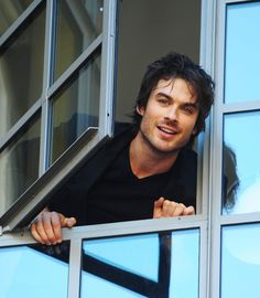 love love love him. that my friends is damon salvatore hanging out a window.