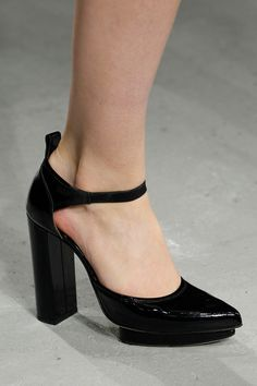 Christopher Kane Autumn 2014 Collection, black patent leather platform heels with ankle straps.