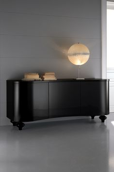 A solid beech wooden structure curvaceous by design, with a matt black lacquered finish to the structure and statement onion wooden turned legs in a contrasting high gloss lacquer. The fabulous doors are fitted with a push opening mechanism to enhance the fabulous minimal look and feel. The High End Designer Italian Black Buffet Sideboard at Juliettes Interiors is a truly stunning statement for any room in the house.
