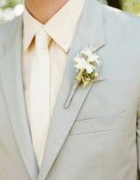 blue gray suit with white tie