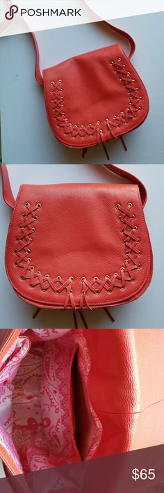 "Beautiful coral whip stitched handbag-crossbody Only used once! Fashionable, fun and versatile! I love the color of this bag and the fact you can be hands free! It has 3 pockets inside. Magnetic snap. Great details on the front. Whip stich and a few fringes that makes this bag playful. The strap is approximately 26"" in length, and is adjustable. The mouth of the bag is 10"" in length and 61/2"" across. Inside, the white and coral parsley print adds a special touch! Violetta Bags Shoulder Bags"