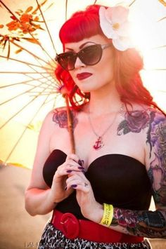 Loving the red hair and tats and the flowers...just so great