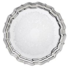 A classic tray that acts as a graceful display and a practical server, this blends beautifully with contemporary or antique decor. Leave a lasting impression on your guests with a magnificent presentation in your home. Antique Decor, Silver Trays, Silver Plate, Round Tray, Reed & Barton, Serving Dishes, Emboss, Classic Style