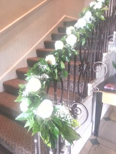 A bannister at Wood Hall decorated for the wedding photos