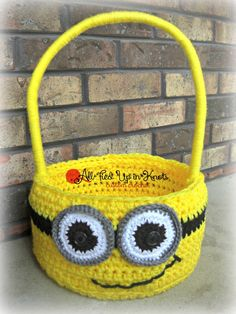 Crocheted Minion Easter Basket. Base basket pattern by A Crocheted Simplicity. Stitched by All Tied Up In Knots. www.facebook.com/alltiedupinknots www.etsy.com/shop/homemadebyholmberg