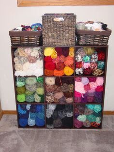 Very easy and affordable yarn storage idea. Wooden storage cube shelf and baskets.
