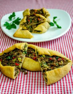 Turkish Pide with Ground Beef always makes a perfect meal! Pide is one of the tasty fast foods in Turkish cuisine. It has lots of varieti...