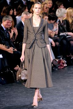 Louis Vuitton Fall 2010 Ready to Wear: The New Look, the coat is synched in at the waist and the skirt underneath becomes full, bottom of jacket has a peplum look to it