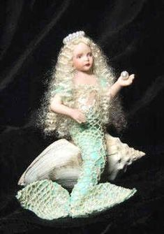 Make a miniature Mermaid     -    These instructions will show you how to create your own fantasy mermaid    This is a quick and easy project with fabulous results!    Doll shown is Pearl by Doreen Sinnett.    DoreenSinnettDolls.com