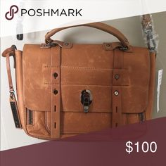 NWT Via Spiga leather purse Can carry or has removable adjustable strap. Front closure. Inside pockets and outside zippered pocket! Very cute! Debating on keeping if it doesn't sell first!! Via Spiga Bags Crossbody Bags