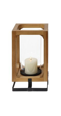 Illuminate the coziest spot in the house with the help of this gorgeous wood lantern. Clean and contemporary in design, the Lorna Lantern features gorgeous wood framing and a sleek metal base. Use it w...  Find the Lorna Lantern, as seen in the Rustic Luxe in Park City Collection at http://dotandbo.com/collections/rustic-luxe-in-park-city?utm_source=pinterest&utm_medium=organic&db_sku=115024