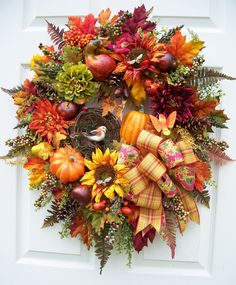 Beautiful fall colors in this swag. http://www.timelessfloralcreations.com/