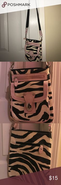 Zebra Purse Zebra print bag with an removable, adjustable strap. Baby pink accents around the trip and zippers. Two compartments on the front side with one in the back, along with another one in the middle. Very cute and light weight, lots of room! Bags Shoulder Bags