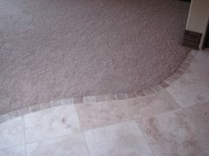 Nice detail. Great way to transition from carpet to tile, especially on a curve.