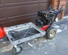 Homemade powered barrow constructed from a surplus snowblower, pneumatic casters, angle iron, and plywood. Metal Projects, Welding Projects, Farm Projects, Blacksmith Projects, Welding Art, Cool Tools, Diy Tools, Powered Wheelbarrow, Landscaping Equipment
