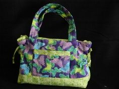 I made one of these purses.  Love it!  Lots of room and a hard bottom.  Washable to!