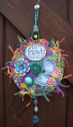 Altered CDs-blue multi with Friends sentiment & butterfly.